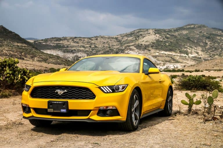 Yellow muscle car Ford Mustang in the desert, How Many Seats Does A Ford Mustang Have?