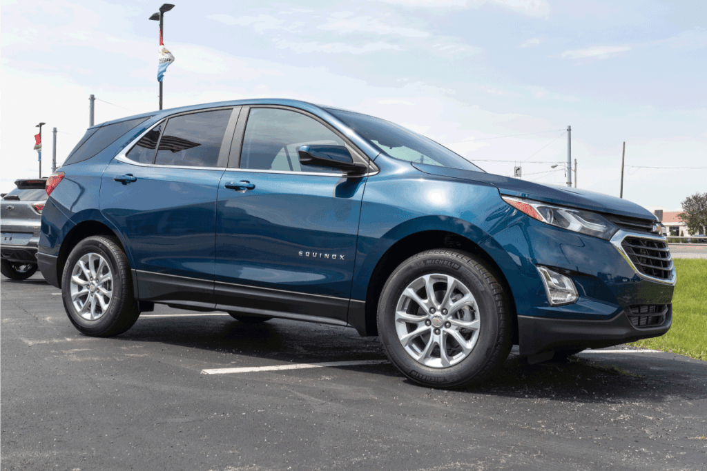 blue chevy equinox on display at the open parking of a dealer. How Much Weight Can A Chevy Equinox Carry