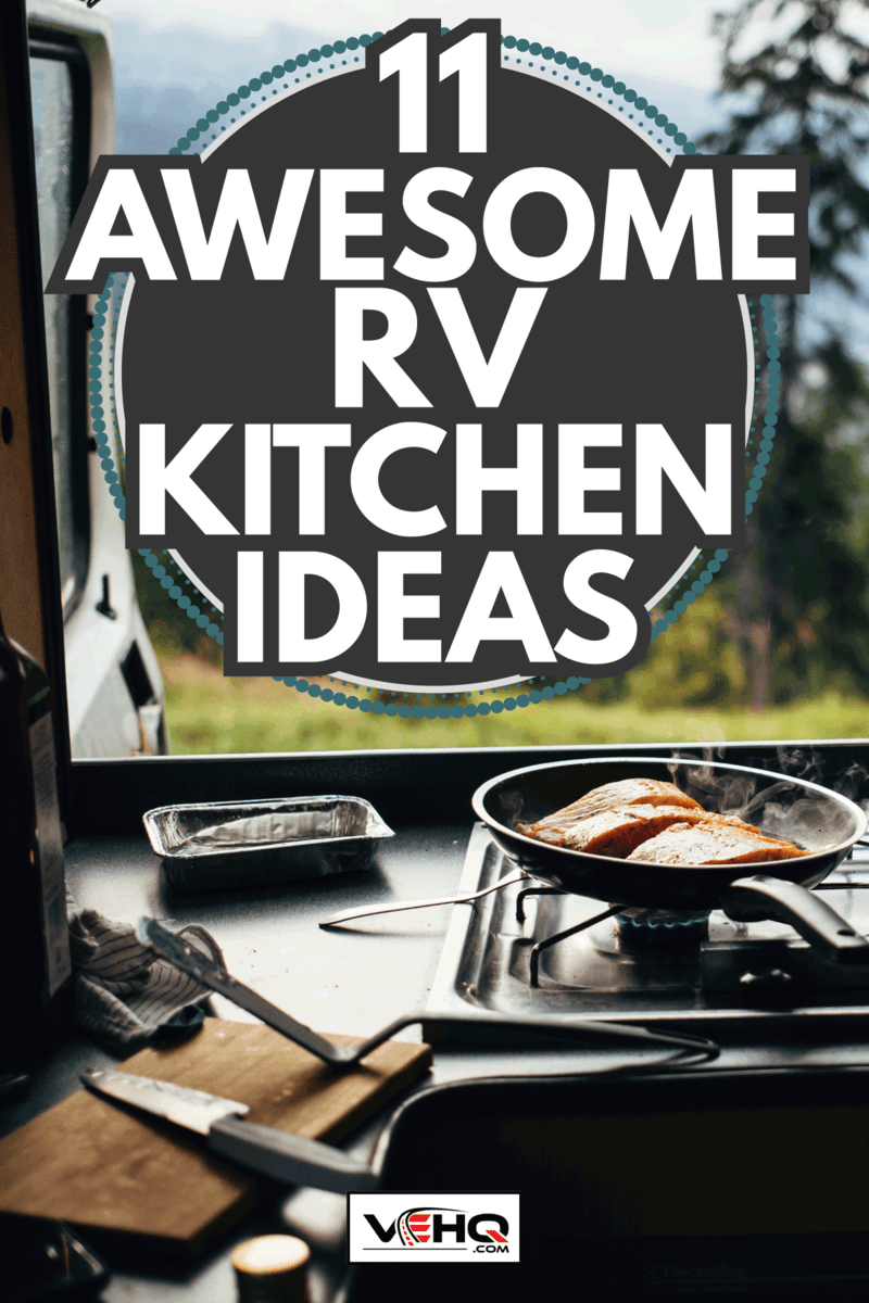 frying pan with organic salmon prepared in inside camper van on campsite in mountains or forest. 11 Awesome RV Kitchen Ideas