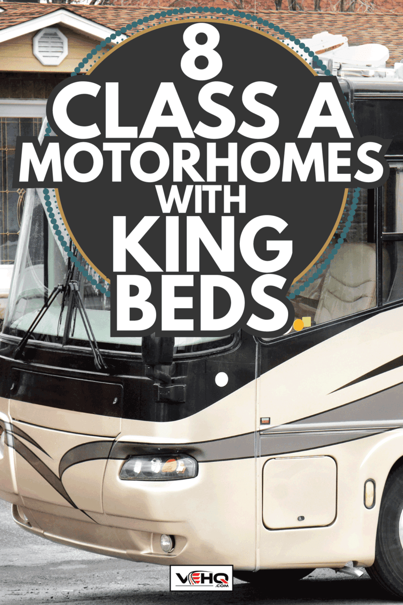 large recreational vehicle, class A motorhome parked along the road of a suburban neighborhood. 8 Class A Motorhomes With King Beds