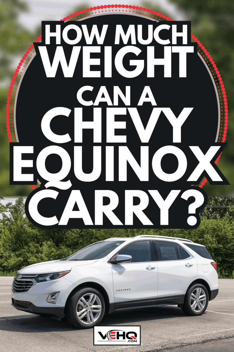 white chevy equinox parked at the side of a tree lined road. How Much Weight Can A Chevy Equinox Carry