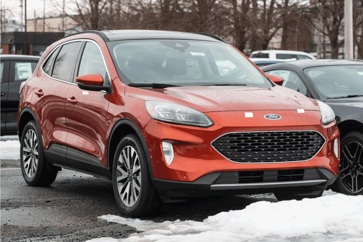 A 2020 Ford Escape Suv at a dealership with snow on the ground