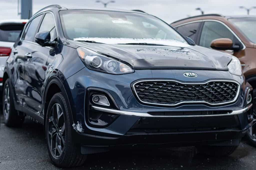 A 2020 Kia Sportage SUV parked at a dealership, How To Remove The Jack From Kia Sportage