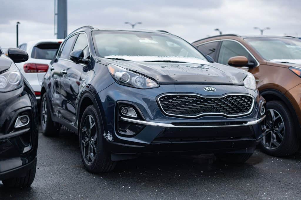 A 2021 black Kia Sportage photographed on the parking lot