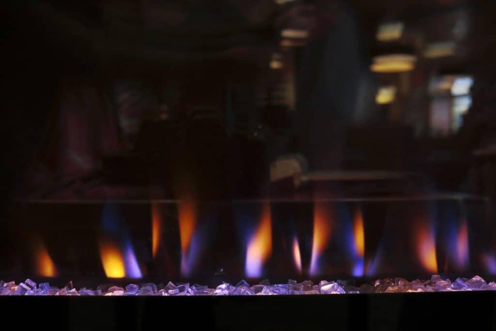 A fireplace burning inside RV