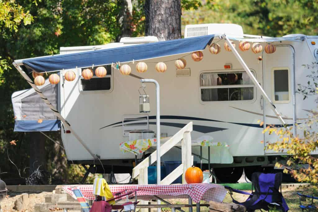 A Halloween inspired RV with pumpkins hanged on the awning