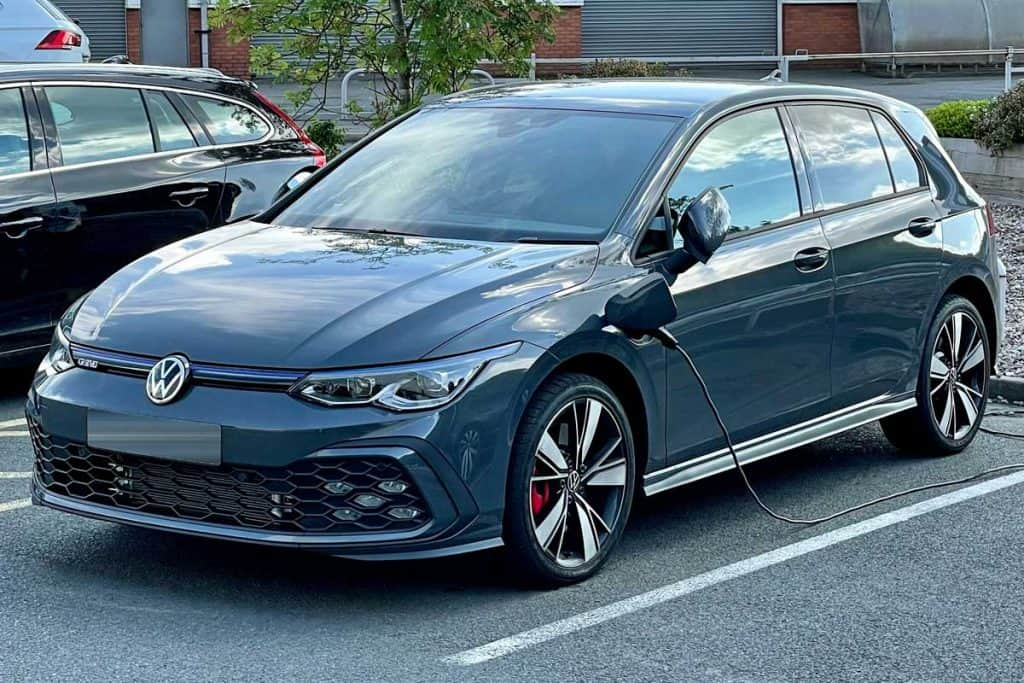A new Volkswagen Golf Mk8 GTE car plugged in at an electric vehicle charging point, Volkswagen Golf Not Starting - What To Do?