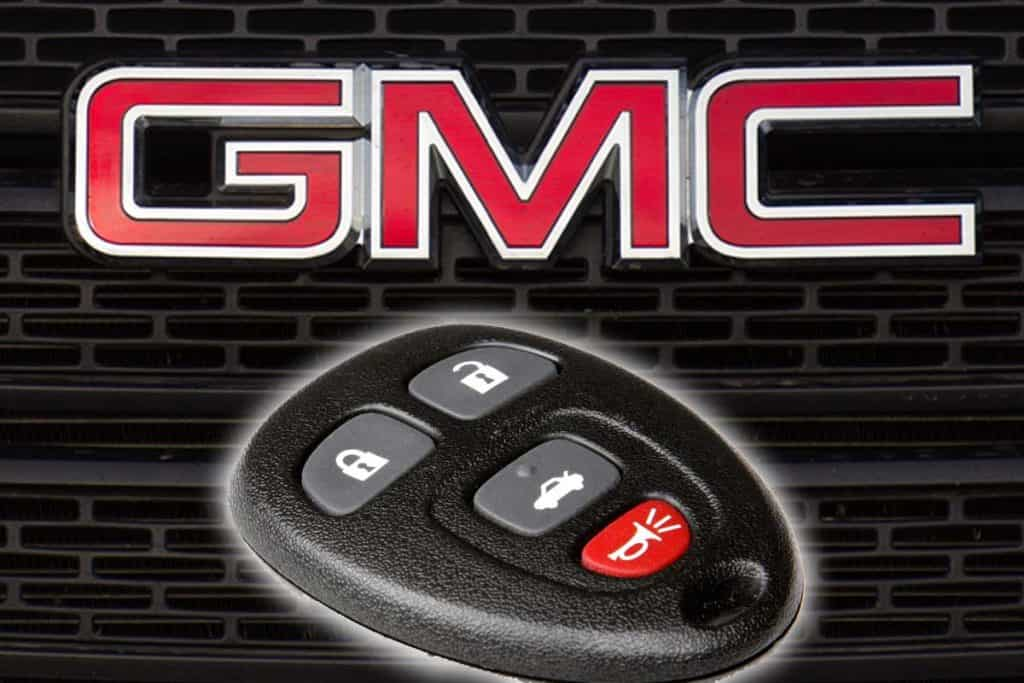 A smart key with GMC logo and grille on the background, How To Program A GMC Savana Key
