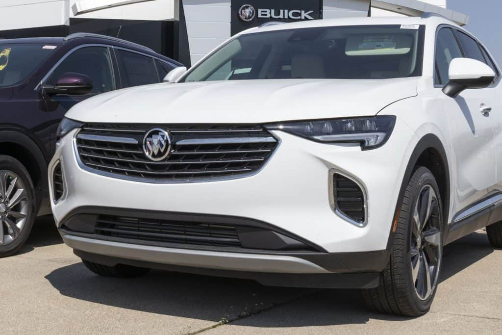 A white and black color Buick Encore parked outside a dealership, Does The Buick Encore Have A Turbo?