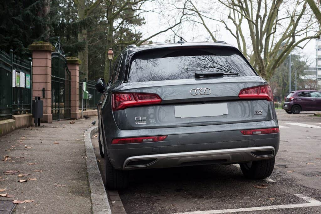 An Audi Q5 parked on the side of the street