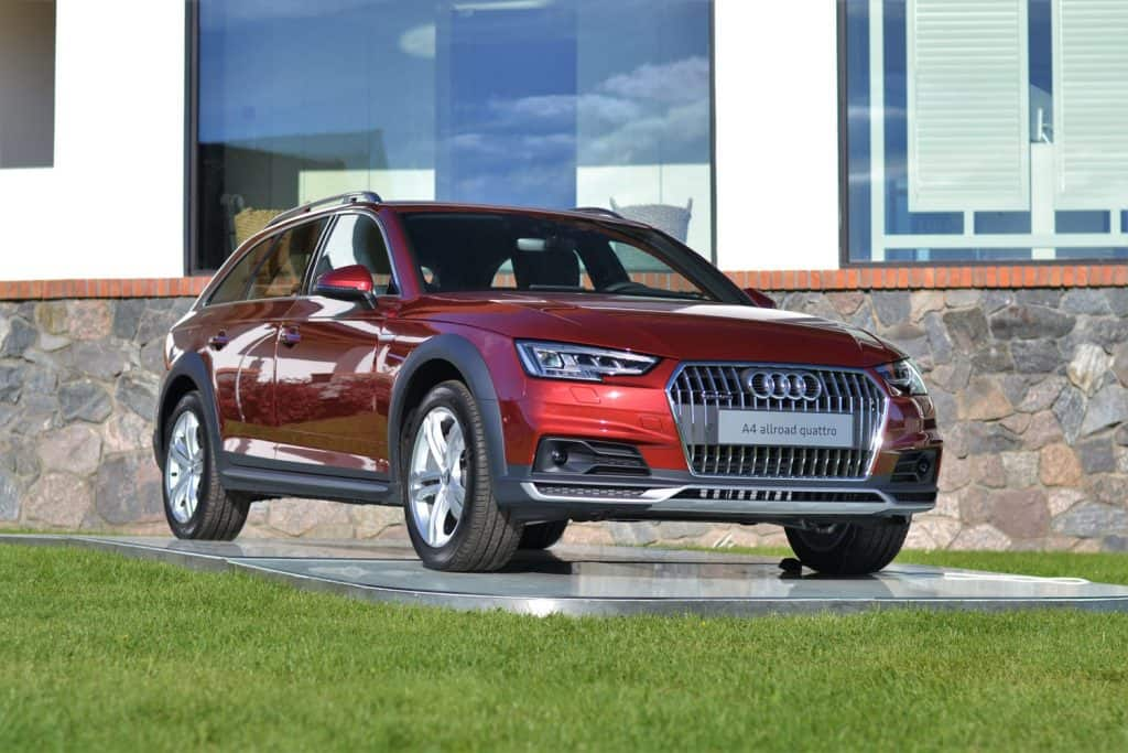 A red Audi A4 allroad parked outside a dealership, Does The Audi A4 Have Folding Mirrors?