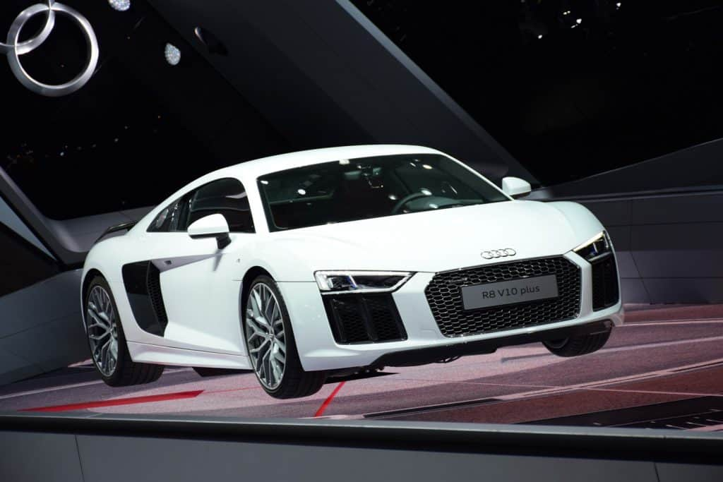 Audi R8 V10 Plus vehicle on the motor show. The supercar from Audi is powered by 5,2-litre petrol engine V10 (pushing out 585 HP