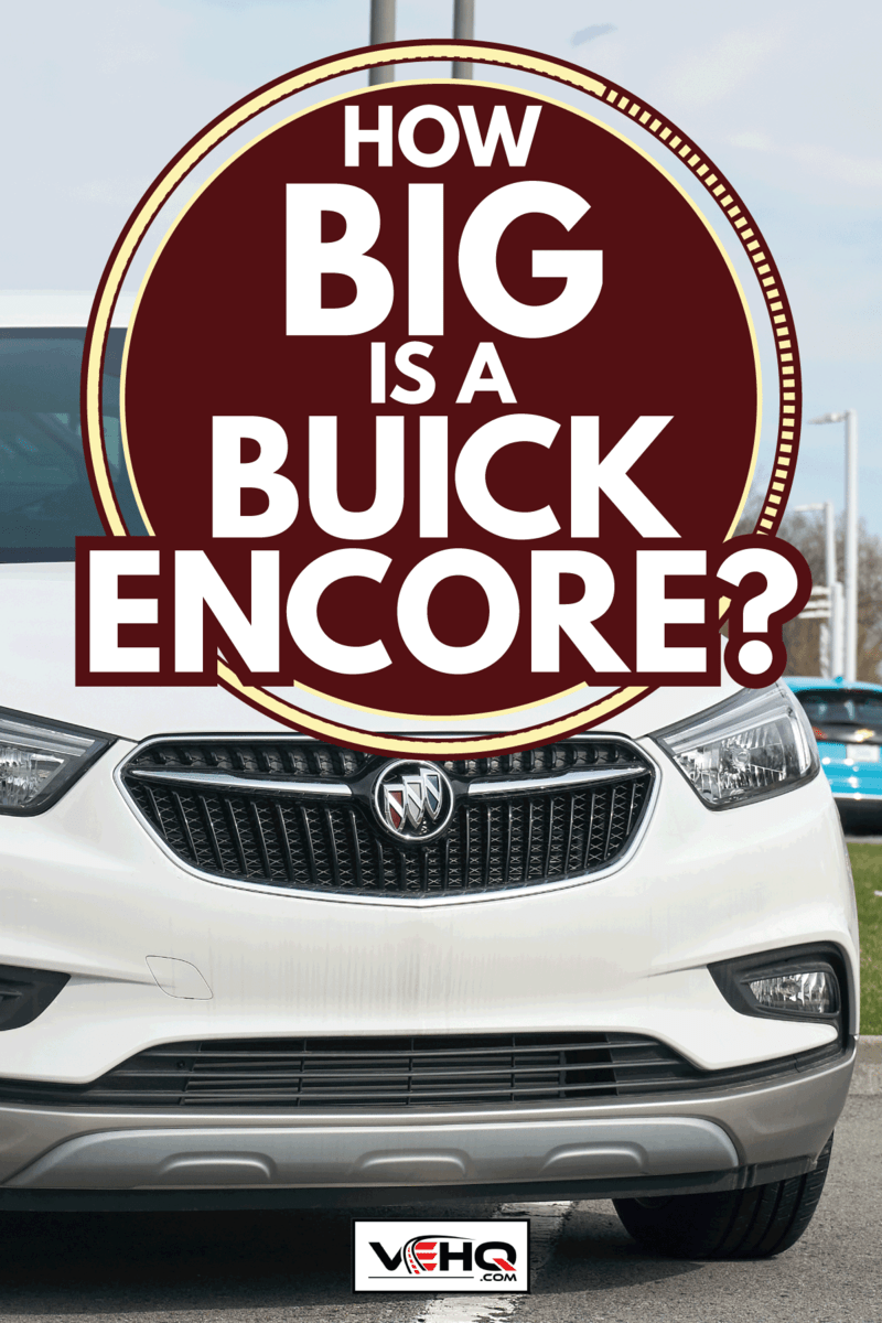 Buick Encore 2020 car in white parked in front of a dealership. How Big Is A Buick Encore