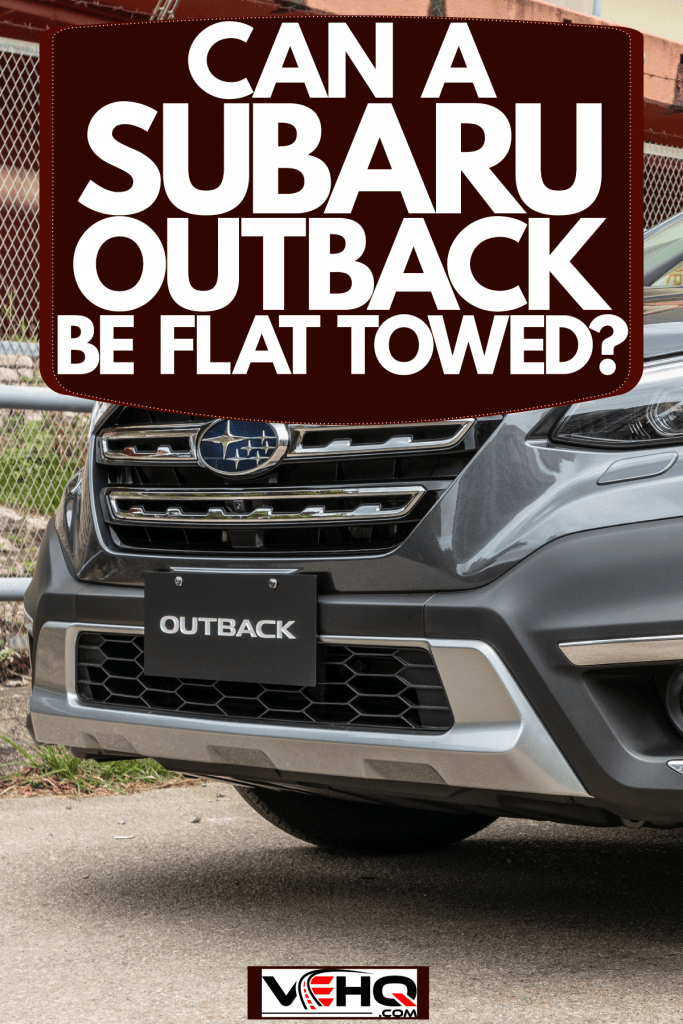 A black colored Subaru Outback parked outside a building, Can A Subaru Outback Be Flat Towed?