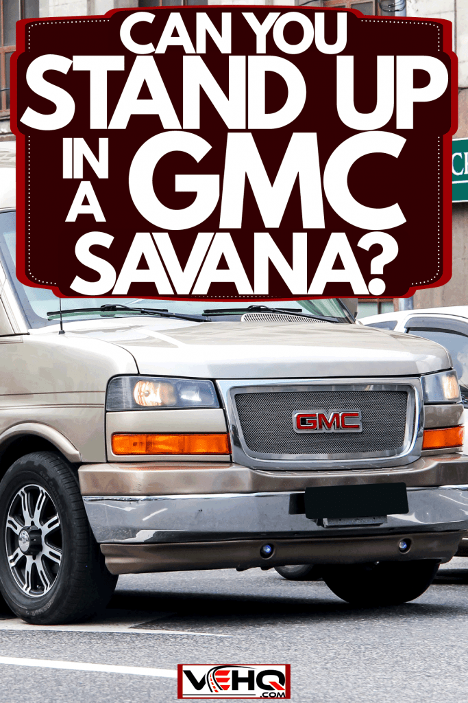 A huge brown color GMC Savana moving on the streets, Can You Stand Up In A GMC Savana?