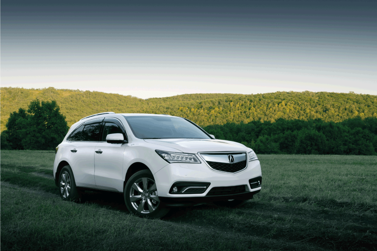 Car Acura MDX is parked at the countryside at sunset