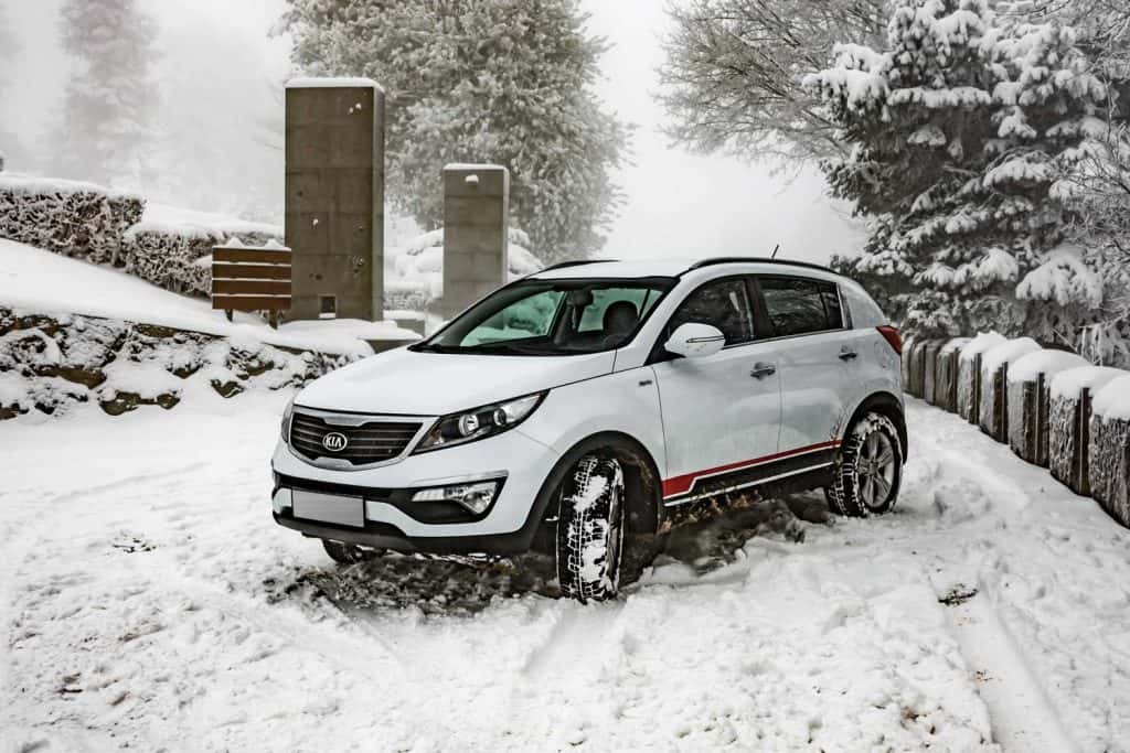 Car Kia Sportage 2.0 CRDI covered with deep snow and ice