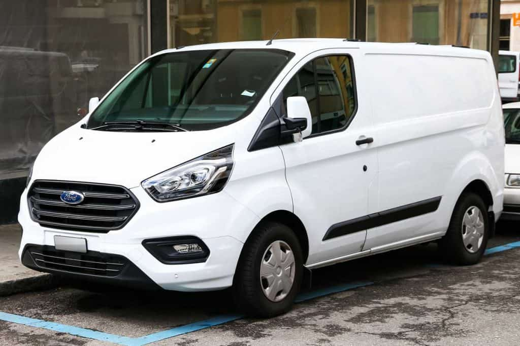 Cargo van Ford Transit in the city street, Can You Add Seats To A Ford Transit Cargo Van?