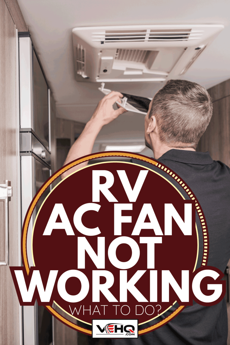Caucasian RV Caravaning Technician Replacing Air Condition Filter Inside Travel Trailer. Recreational Vehicles and Travel Industry. RV AC Fan Not Working - What To Do