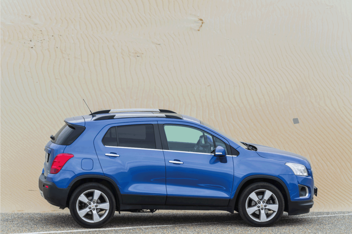 Chevy trax on the side of the road in the dunes.