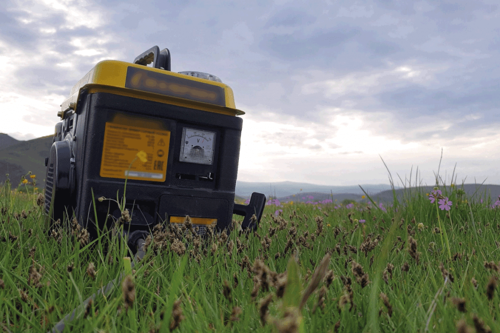 Close up of gas diesel mobile portable electricity generator work on grass. How Long Can A Troy Bilt Generator Run