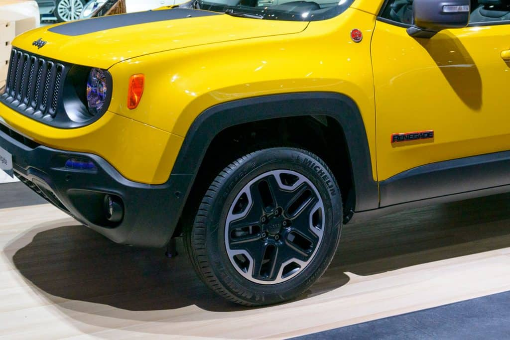 Close up photo of Jeep Renegade's tire crossover SUV on display during the 2015 Brussels motor show.,What Are The Best Tires For Jeep Renegade?