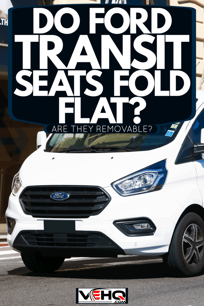 A white Ford Transit parked on the side of a building, Do Ford Transit Seats Fold Flat? Are They Removable?