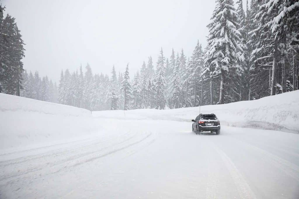 Driving on a snow covered mountain road