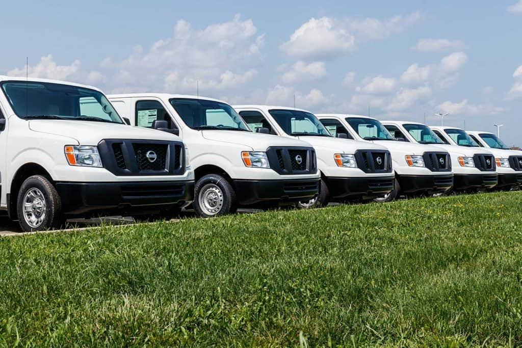 Fleet of Nissan NV Cargo Trucks