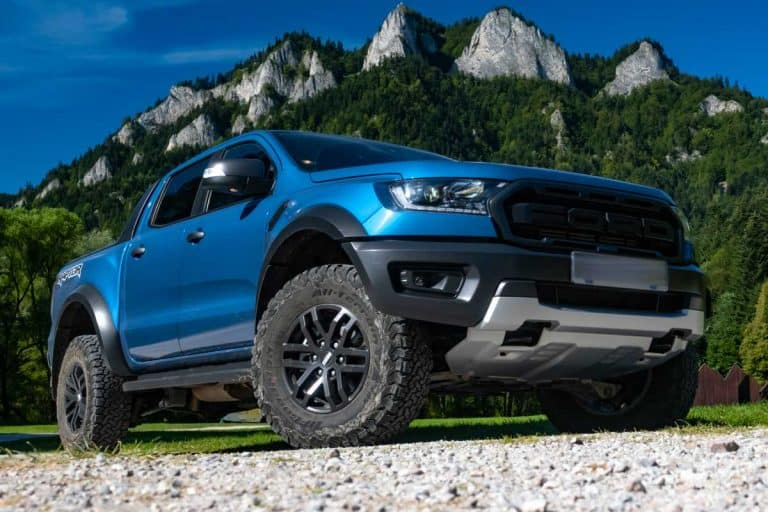 Ford Ranger Raptor on a road in mountain scenery, How Much Weight Can Ford Ranger Carry?