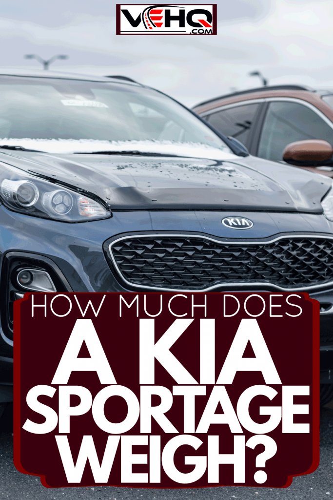 A 2021 black Kia Sportage photographed on the parking lot, How Much Does A Kia Sportage Weigh?