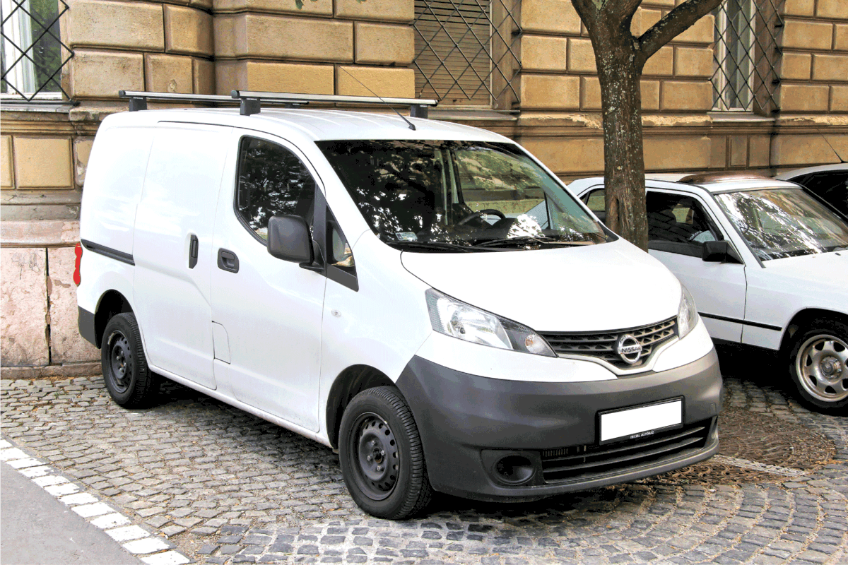 Japanese cargo van Nissan NV200 at the city street. Do Nissan NV Seats Recline Or Fold Down