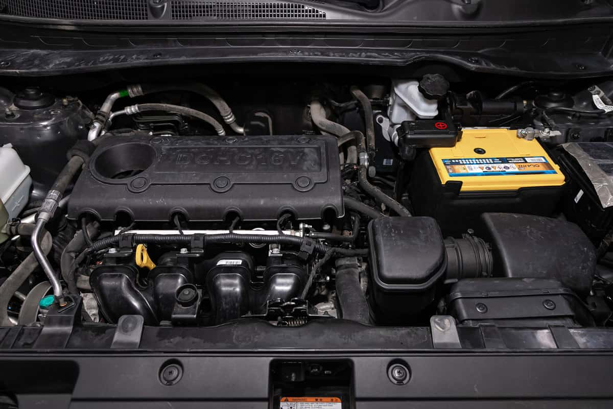 Kia Sportage, Close up detail of car engine, front view. Internal combustion engine, car parts
