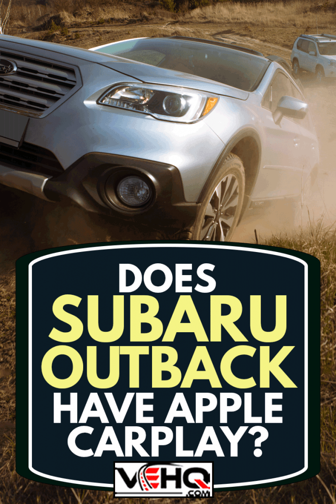 subaru outback suv car trying to get up by dusty hill. nissan x-trail on background, Does Subaru Outback Have Apple CarPlay?