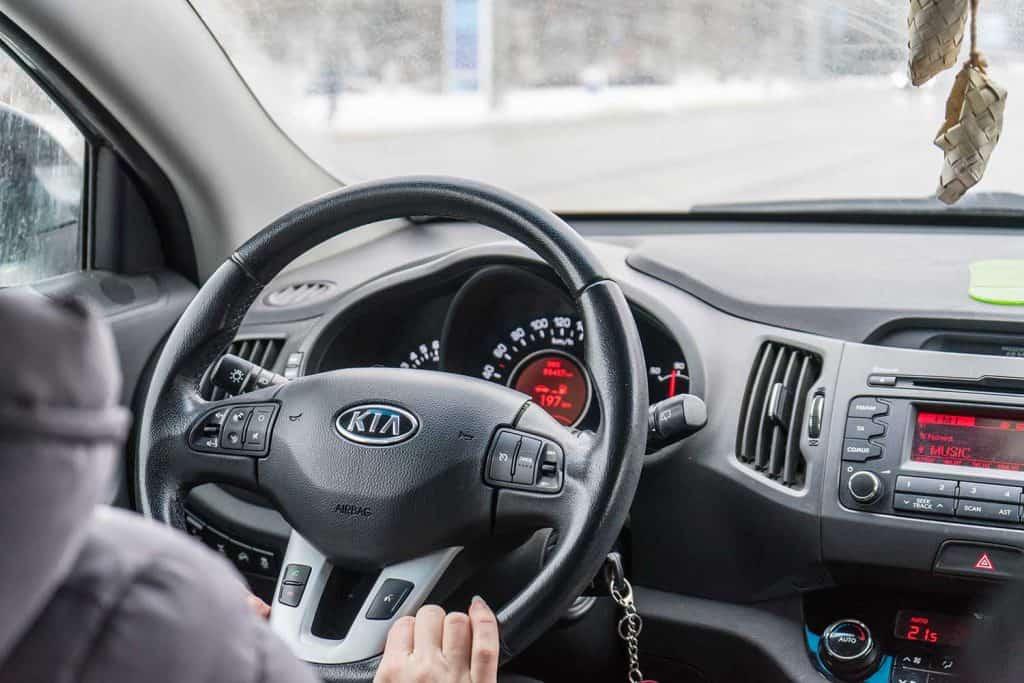 Man driving a KIA car