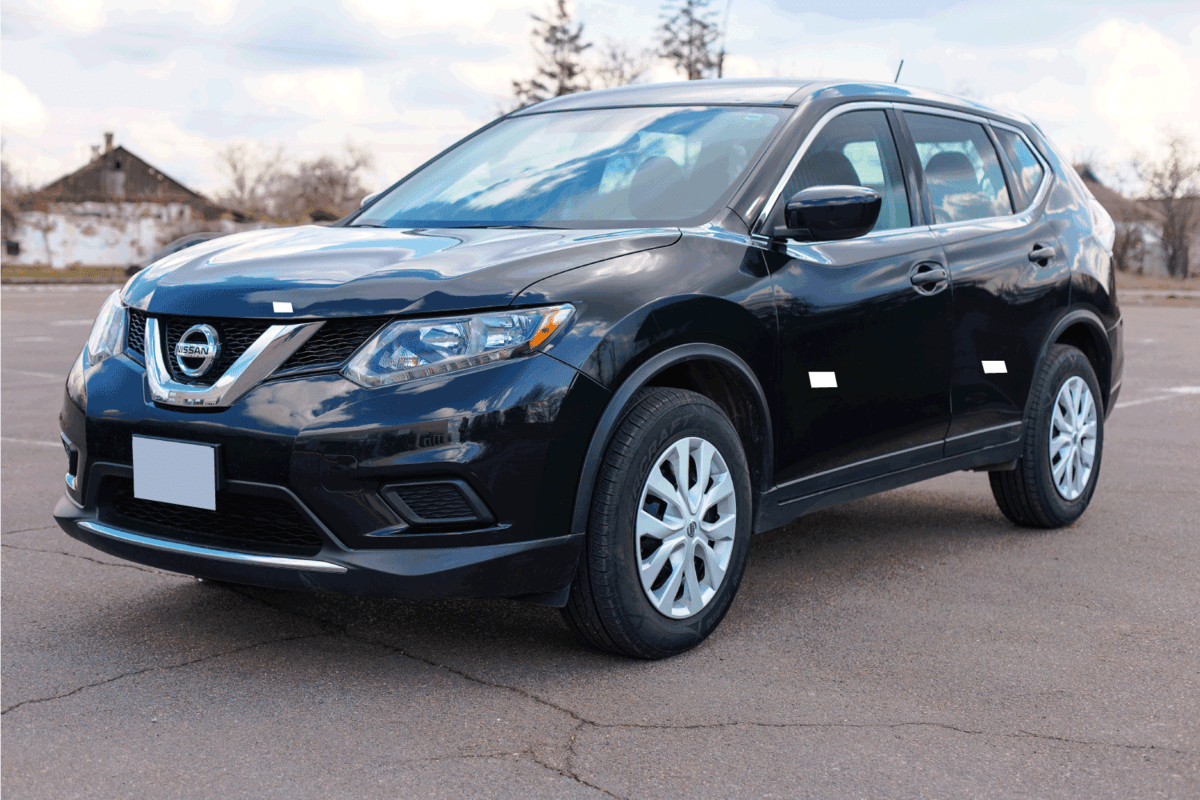 Photo of black Nissan Rogue in the open air