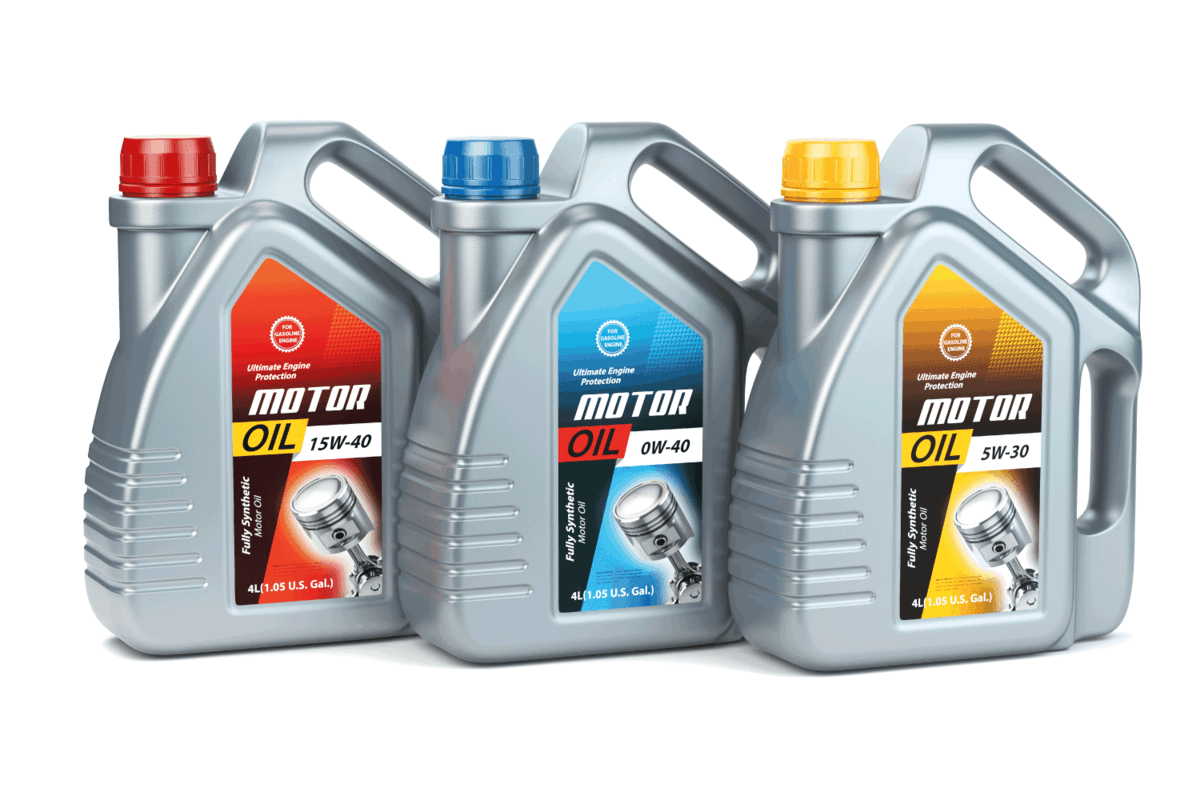 Plastic motor oil canisters with different types of motor oil on white isolated background. What's the Best Oil for Buick Encore [And How Often to Change It]