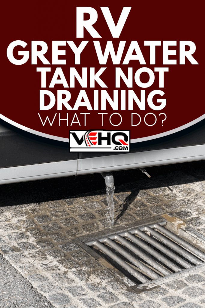 Close up view of proper disposal of gray water and waste water from a camper van at an RV park, RV Grey Water Tank Not Draining - What To Do