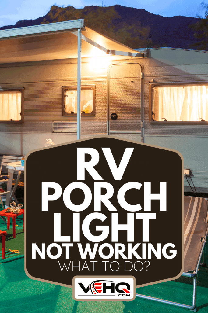 A trailer caravan on a camping site illuminated at night, RV Porch Light Not Working - What To Do?