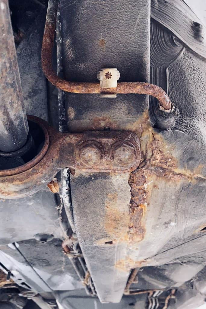 Rust building up on the underside of a car