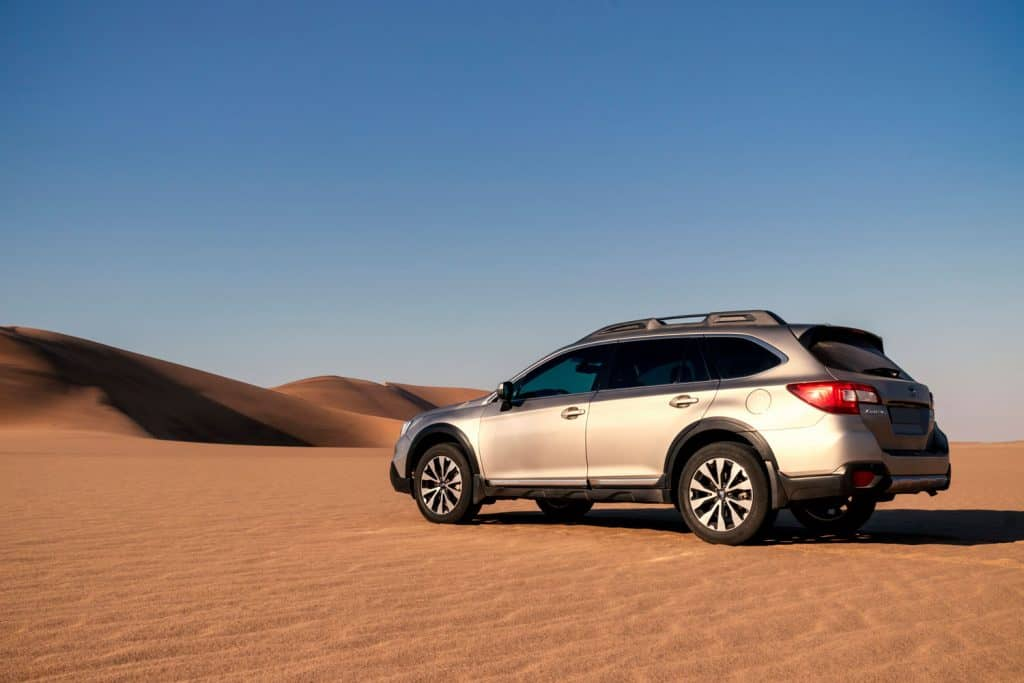 Subaru Outback standing in the middle of the Namib desert