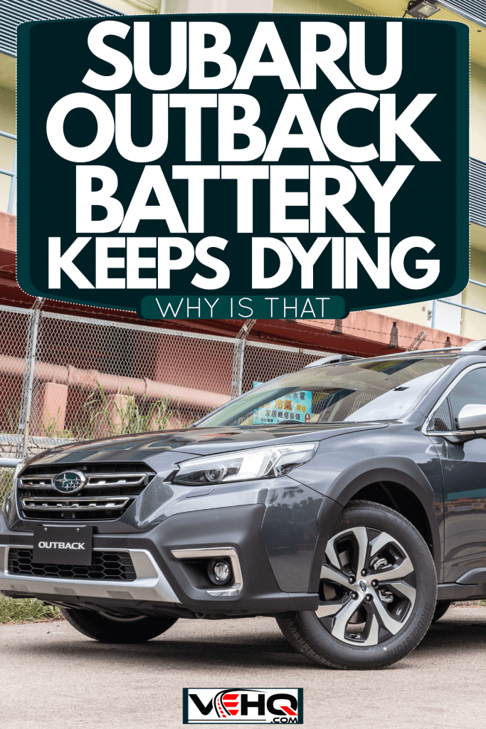 A black Subaru outback parked next to a building, Subaru Outback Battery Keeps Dying - Why Is That?