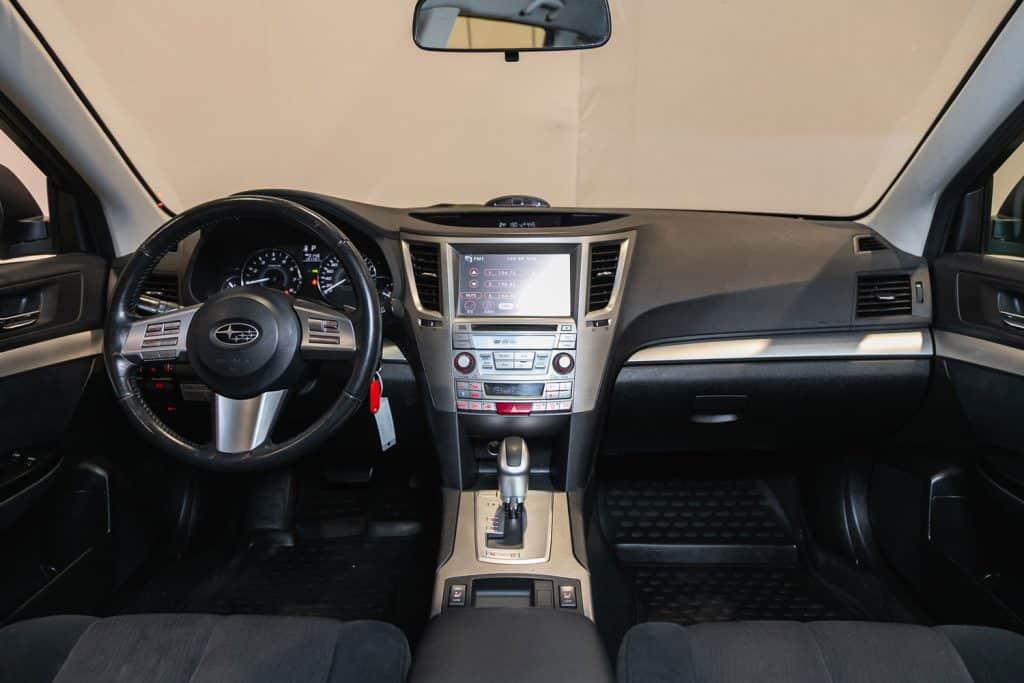 Subaru Outback, Interior of new modern SUV car with automatic transmission, dashboard