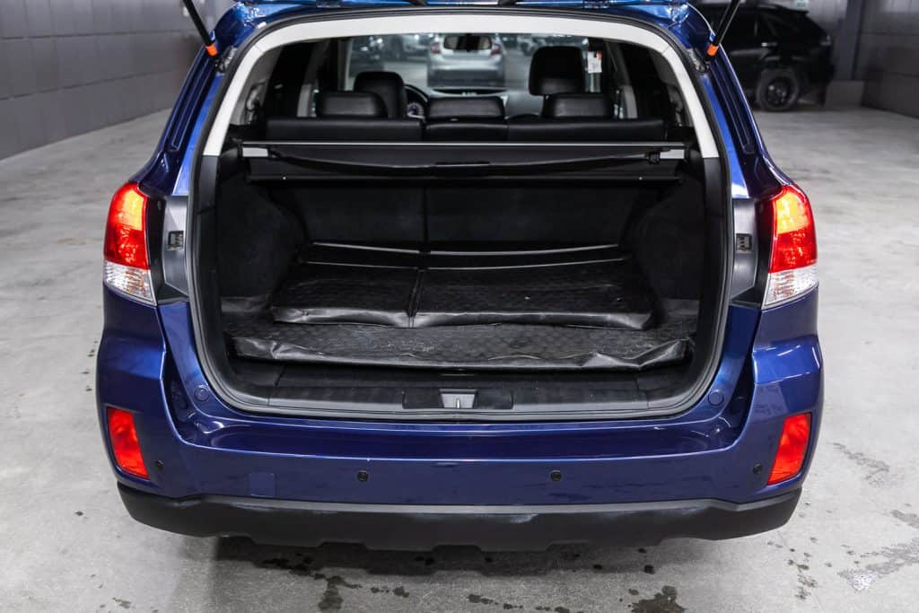 Subaru Outback, close-up of the open trunk, headlight, bumper, front view