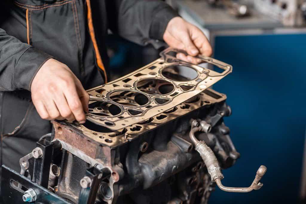 The mechanic disassemble block engine vehicle