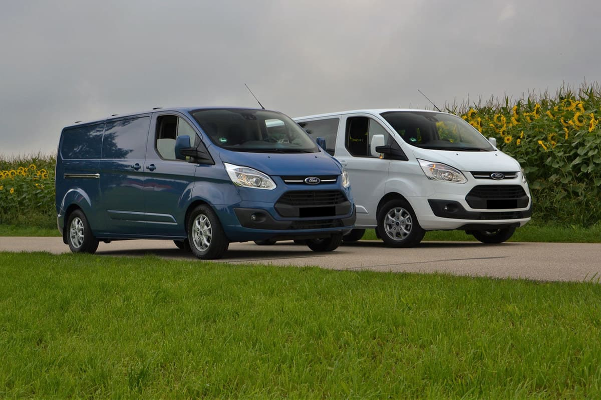 Two Ford Transits parked on the side of the road
