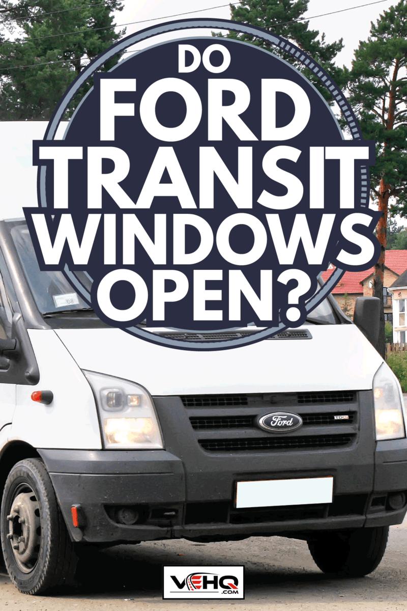 White Ford Transit passenger van drives at the interurban road. Do Ford Transit Windows Open