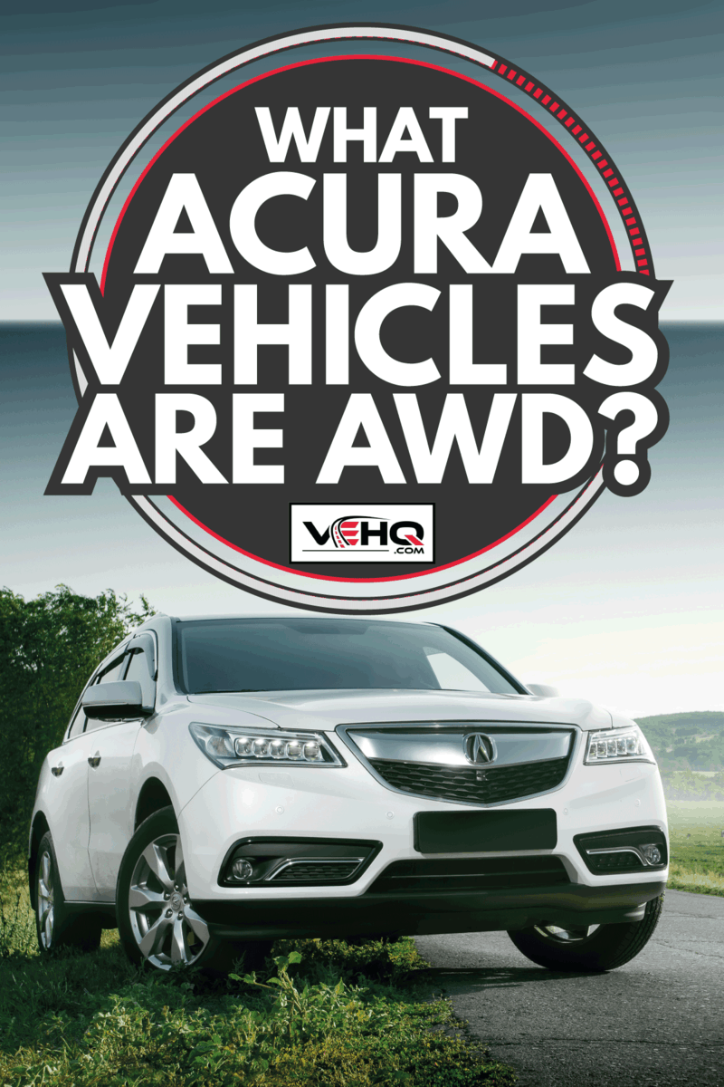 White car Acura MDX Advance standing near asphalt road at sunset. What Acura Vehicles Are AWD