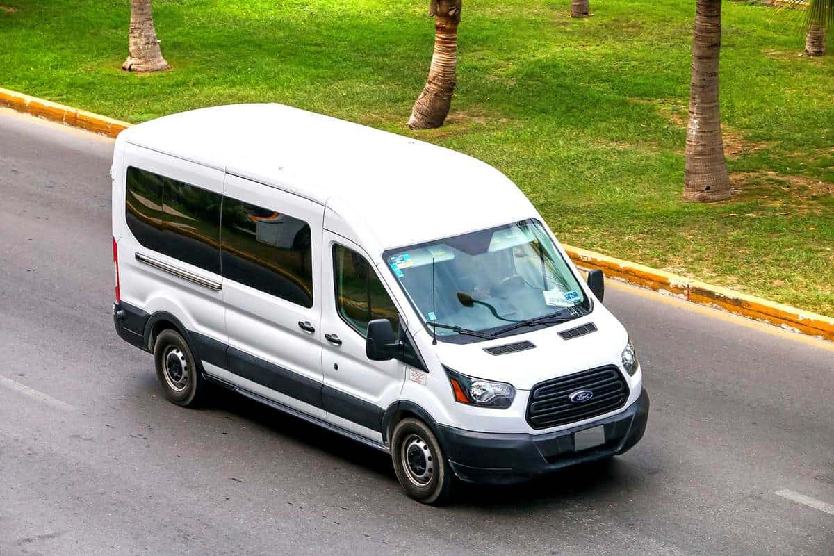 White van Ford Transit in the city street