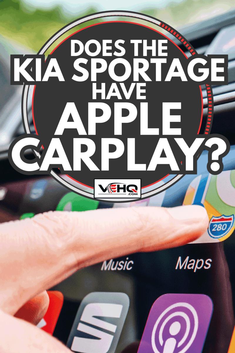 Woman pressing button on Apple Carplay gps maps. Does The Kia Sportage Have Apple CarPlay
